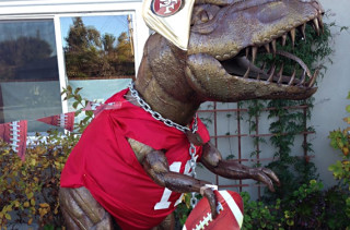 This Lawn Dinosaur Knows How to Dress For Every Occassion