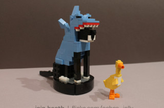 LEGO Cat in a Shark Costume Riding a Roomba