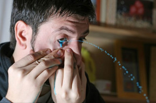 Artist Paints With Eye Squirts