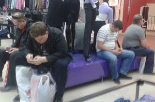 Men Waiting For Women Shopping