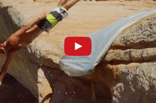 Would You Ride A Slip N Slide Off A 50-Ft Cliff?