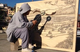 An Artist Uses A Magnifying Glass & The Sun To Make Art