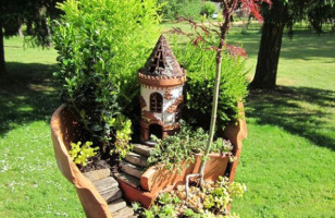 Broken Flower Pots Turned Into Whimsical Fairy Gardens