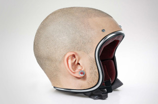 A Collection Of Helmets That Look Like Real Human Heads
