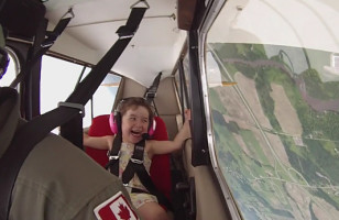 Watch This Little Girl Squeal With Delight While Riding In Her Daddy's Stunt Plane… So Cute!
