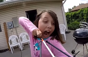 Watch This Little Girl Use A Slingbow To Pull A Loose Tooth