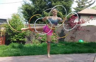 Watch This Girl Spin 9 Hula Hoops On Her Body At The Same Time!