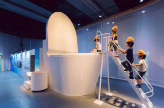 Children Dress As Poop & Jump In A Giant Toilet, Because Japan