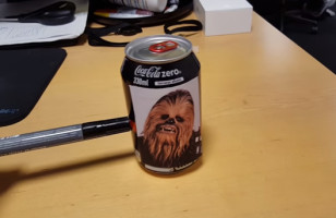 Cokebacca Is A Coke Can That Sounds Like Chewbacca When It's Pushed Across A Table