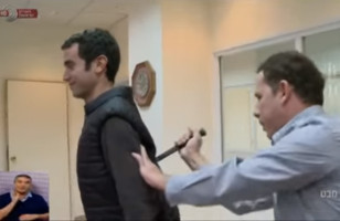 A Reporter Demonstrates An ALLEGED Stab-Proof Vest