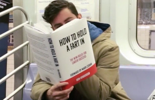 "A Comedian ""Reads"" Hilariously Fake Books On The Subway"