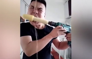 Watch This Guy Eat Corn On The Cob Using A Power Drill
